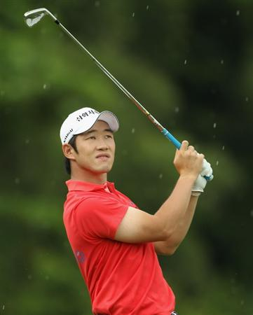 SINGAPORE - NOVEMBER 14:  Kang Kyung-nam of Korea in action during the Final Round of the Barclays Singapore Open at Sentosa Golf Club on November 14, 2010 in Singapore, Singapore.  (Photo by Ian Walton/Getty Images)