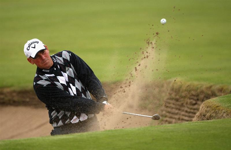 CARNOUSTIE, SCOTLAND - OCTOBER 02:  Thomas Bjorn of Denmark plays his fifth shot on the 18th hole during the second round of The Alfred Dunhill Links Championship at Carnoustie Golf Club on October 2, 2009 in Carnoustie, Scotland. (Photo by Andrew Redington/Getty Images