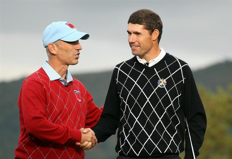 NEWPORT, WALES - OCTOBER 03:   Padraig Harrington of Europe is congratulated by USA Captain Corey Pavin (L) after winning his match on the 17th green during the Fourball & Foursome Matches during the 2010 Ryder Cup at the Celtic Manor Resort on October 3, 2010 in Newport, Wales.  (Photo by Jamie Squire/Getty Images)