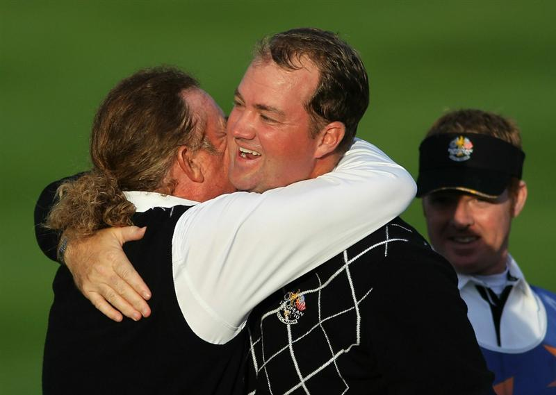 NEWPORT, WALES - OCTOBER 03:  Miguel Angel Jimenez of Europe celebrates with Peter Hanson (R) on the 18th green during the Fourball & Foursome Matches during the 2010 Ryder Cup at the Celtic Manor Resort on October 3, 2010 in Newport, Wales.  (Photo by Jamie Squire/Getty Images)