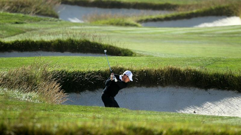 PEBBLE BEACH, CA - JUNE 17:  Justin Leonard plays a bunker shot during the first round of the 110th U.S. Open at Pebble Beach Golf Links on June 17, 2010 in Pebble Beach, California.  (Photo by Donald Miralle/Getty Images)