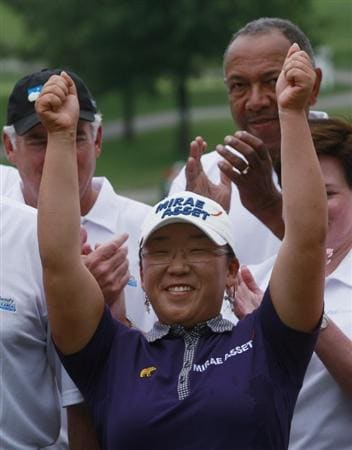 ROGERS, AR - SEPTEMBER 13:  Jiyai Shin of South Korea reacts after winning the P&G Beauty NW Arkansas Championship at the Pinnacle Country Club on September 13, 2009 in Rogers, Arkansas.  (Photo by Dave Martin/Getty Images)