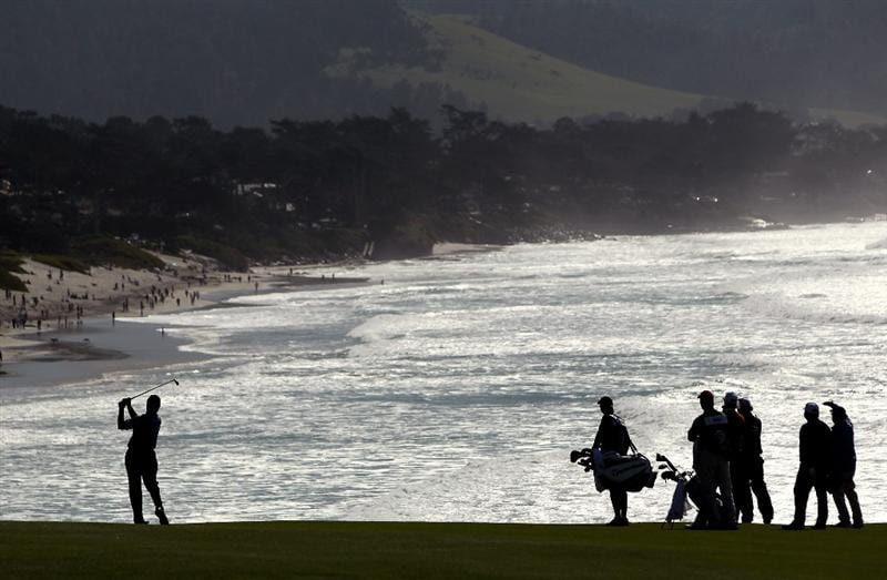PEBBLE BEACH, CA - FEBRUARY 14: Paul Goydos hits his second shot on the ninth hole during the final round of the AT&T Pebble Beach National Pro-Am at Pebble Beach Golf Links on February 14, 2010 in Pebble Beach, California.  (Photo by Ezra Shaw/Getty Images)