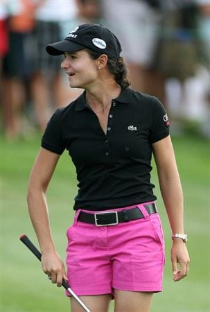 CALGARY, AB - SEPTEMBER 03: Lorena Ochoa of Mexico smiles after hitting her third shot on the 18th hole during the first round of the Canadian Women's Open at Priddis Greens Golf & Country Club on September 3, 2009 in Calgary, Alberta, Canada. (Photo by Hunter Martin/Getty Images)
