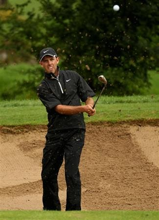 JOHANNESBURG, SOUTH AFRICA - JANUARY 16:  Charl Schwartzel of South Africa chips in out of the 13th greenside bunker for birdie during the fourth round of the Joburg Open at Royal Johannesburg and Kensington Golf Club on January 16, 2011 in Johannesburg, South Africa.  (Photo by Warren Little/Getty Images)