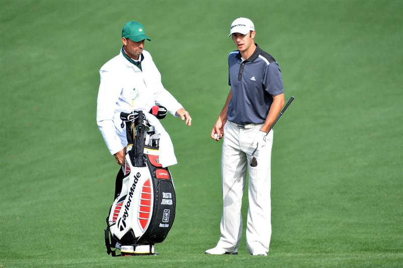 AUGUSTA, GA - APRIL 06:  Dustin Johnson waits with his caddie during a practice round prior to the 2009 Masters Tournament at Augusta National Golf Club on April 6, 2009 in Augusta, Georgia.  (Photo by Harry How/Getty Images)