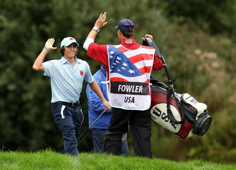 NEWPORT, WALES - OCTOBER 03:  Rickie Fowler of the USA celebrates his eagle on the 11th hole with his caddie Joe Skovron during the Fourball & Foursome Matches during the 2010 Ryder Cup at the Celtic Manor Resort on October 3, 2010 in Newport, Wales.  (Photo by Ross Kinnaird/Getty Images)