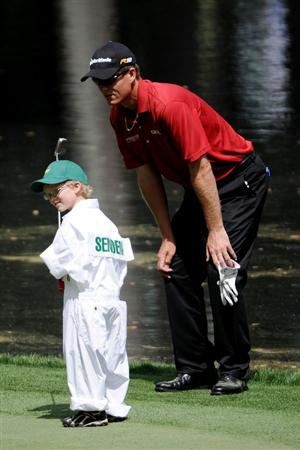 AUGUSTA, GA - APRIL 07:  John Senden of Australia watches his Jacob hit a putt during the Par 3 Contest prior to the 2010 Masters Tournament at Augusta National Golf Club on April 7, 2010 in Augusta, Georgia.  (Photo by Harry How/Getty Images)