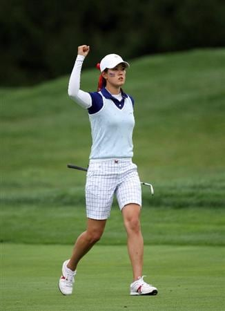 SUGAR GROVE, IL - AUGUST 22:  Michelle Wie of the USA hits her second shot close at the 10th hole during the Saturday afternoon forsome matches at the 2009 Solheim Cup Matches, at the Rich Harvest Farms Golf Club on August 22, 2009 in Sugar Grove, Ilinois  (Photo by David Cannon/Getty Images)