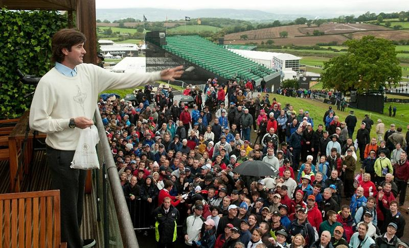 NEWPORT, WALES - OCTOBER 01:  Bubba Watson of the USA throws balls to fans as play is suspended during the Morning Fourball Matches during the 2010 Ryder Cup at the Celtic Manor Resort on October 1, 2010 in Newport, Wales.  (Photo by PGA of America/Getty Images)