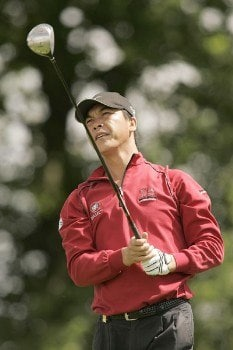 Lian-Wei Zhang watches his tee shot during the rain delayed first round of the 2005 Deutsche Bank Players' Championship at Gut Kaden Golf Club in Hamburg, Germany on July 22, 2005.Photo by Pete Fontaine/WireImage.com