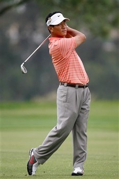 SAN DIEGO - JUNE 12:  K.J. Choi of Korea hits his second shot on the 14th hole during the first round of the 108th U.S. Open at the Torrey Pines Golf Course (South Course) on June 12, 2008 in San Diego, California.  (Photo by Jeff Gross/Getty Images)