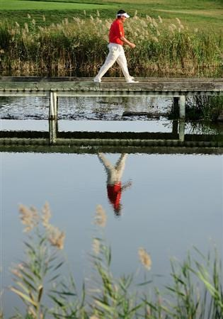 VILAMOURA, PORTUGAL - OCTOBER 18:  Lee Westwood of England walks over a bridge on the 17th hole during the final round of the Portugal Masters at the Oceanico Victoria Golf Course on October 18, 2009 in Vilamoura, Portugal.  (Photo by Stuart Franklin/Getty Images)