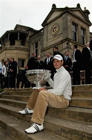 ST ANDREWS, SCOTLAND - OCTOBER 10:  Martin Kaymer of Germany holds the trophy in front of the clubhouse after his victory in the final round of The Alfred Dunhill Links Championship at The Old Course on October 10, 2010 in St Andrews, Scotland.  (Photo by Ross Kinnaird/Getty Images)
