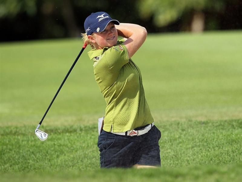 SINGAPORE - FEBRUARY 25:  Stacy Lewis of the USA hits her second shot on the 4th hole during the first round of the HSBC Women's Champions at Tanah Merah Country Club on February 25, 2010 in Singapore, Singapore.  (Photo by Andy Lyons/Getty Images)