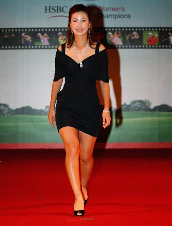 SINGAPORE - MARCH 04:  Momoko Ueda of Japan walks down the runway during the Gala Dinner prior to the start of the HSBC Women's Champions at Tanah Merah Country Club on March 4, 2009 in Singapore.  (Photo by Andrew Redington/Getty Images)