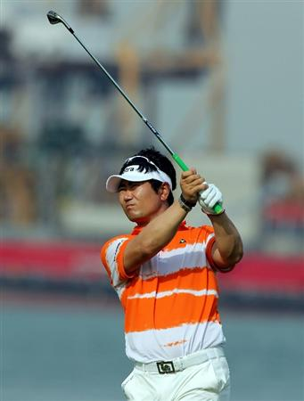 SINGAPORE - NOVEMBER 12:  Y.E. Yang of South Korea hits a shot on the 7th hole during the second round of the Barclays Singapore Open held at the Sentosa Golf Club on November 12, 2010 in Singapore, Singapore.  (Photo by Stanley Chou/Getty Images)