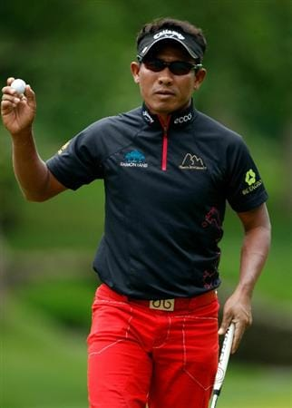 DUBLIN, OH - JUNE 06:  Thongchai Jaidee of Thailand waves to the gallery on the second green during the final round of the Memorial Tournament presented by Morgan Stanley at Muirfield Village Golf Club on June 6, 2010 in Dublin, Ohio.  (Photo by Scott Halleran/Getty Images)