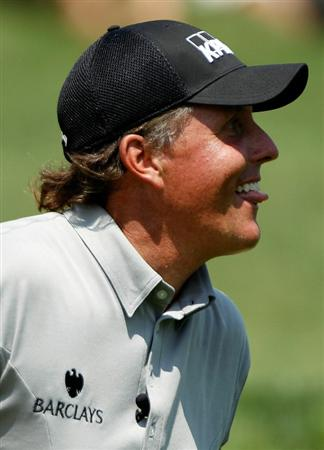 DUBLIN, OH - JUNE 02:  Phil Mickelson smiles after holing a bunker shot during the Memorial Skins Game prior to the start of the 2010 Memorial Tournament at the Muirfield Village Golf Club on June 2, 2010 in Dublin, Ohio.  (Photo by Scott Halleran/Getty Images)