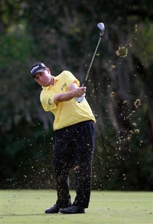 LAKE BUENA VISTA, FL - NOVEMBER 12:  Roland Thatcher plays a shot on the 18th hole during the second round of the Children's Miracle Network Classic at the Disney Palm and Magnolia course on November 12, 2010 in Lake Buena Vista, Florida.  (Photo by Sam Greenwood/Getty Images)