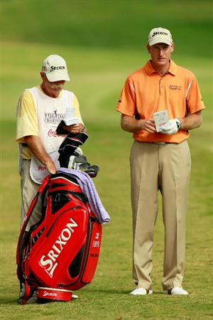 ATLANTA - SEPTEMBER 24:  Jim Furyk waits with his caddie Mike Cowan on the 14th hole during the second round of THE TOUR Championship presented by Coca-Cola at East Lake Golf Club on September 24, 2010 in Atlanta, Georgia.  (Photo by Kevin C. Cox/Getty Images)