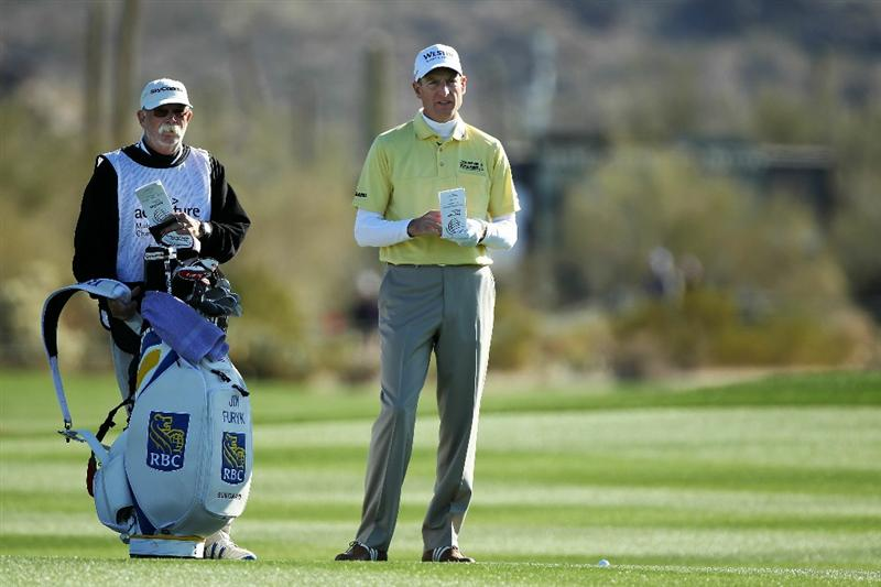 MARANA, AZ - FEBRUARY 23:  Jim Furyk (R) and caddie Mike 'Fluff' Cowan look on from the second hole during the first round of the Accenture Match Play Championship at the Ritz-Carlton Golf Club on February 23, 2011 in Marana, Arizona.  (Photo by Andy Lyons/Getty Images)