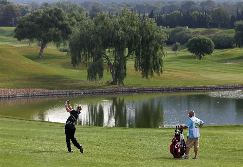 MALLORCA, SPAIN - MAY 14:  Ross McGowan of England plays his second shot on the 5th hole during day three of the Iberdrola Open at Pula Golf Club on May 14, 2011 in Mallorca, Spain.  (Photo by Julian Finney/Getty Images)