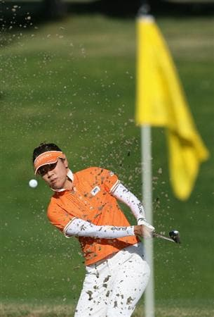 RANCHO MIRAGE, CA - SEPTEMBER 16:  Shiho Oyama of Japan hits out of the bunker on the 12th hole during the first round of the LPGA Q-School Sectional Qualifying at Mission Hills Country Club on September 16, 2008 in Rancho Mirage, California.  (Photo by Christian Petersen/Getty Images)