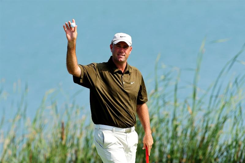 CHASKA, MN - AUGUST 14:  Stewart Cink waves to the gallery on the 16th green during the second round of the 91st PGA Championship at Hazeltine National Golf Club on August 14, 2009 in Chaska, Minnesota.  (Photo by Stuart Franklin/Getty Images)