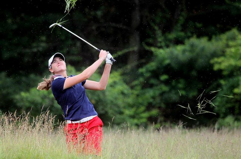 MANCHESTER, MA - JUNE 12:  Cydney Clanton in the United States works out of the rough in Four Ball competition during the second day of the 2010 Curtis Cup Match at the Essex Country Club on June 12, 2010 in Manchester, Massachusetts. (Photo by Jim Rogash/Getty Images)