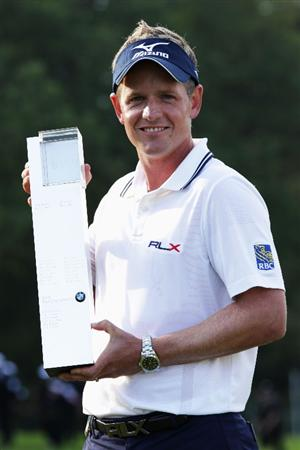 VIRGINIA WATER, ENGLAND - MAY 29:  Luke Donald of England holds the trophy following his victory in a playoff on the 18th green, which also secured him the Number one World ranking during the final round of the BMW PGA Championship  at the Wentworth Club on May 29, 2011 in Virginia Water, England.  (Photo by David Cannon/Getty Images)