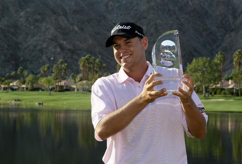 LA QUINTA, CA - JANUARY 25:  Bill Haas poses with the trophy after winning the Bob Hope Classic at the Palmer Private Course at PGA West on January 25, 2010 in La Quinta, California.  (Photo by Jeff Gross/Getty Images)