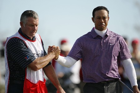 MARANA, AZ - FEBRUARY 23:  Tiger Woods shakes hands with caddie Steve Williams after defeating Henrik Stenson 2 up in the semifinal matches of the WGC-Accenture Match Play Championship at The Gallery at Dove Mountain on February 23, 2008 in Marana, Arizona.  (Photo by Travis Lindquist/Getty Images)