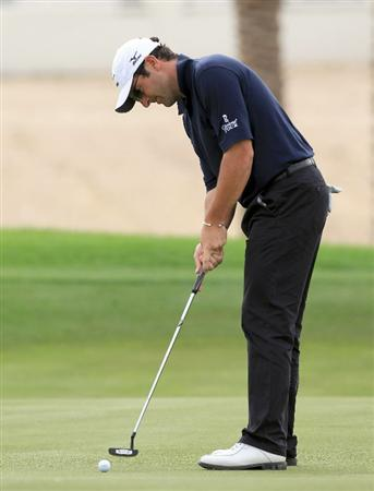 BAHRAIN, BAHRAIN - JANUARY 28:  David Dixon of England putting on the 17th hole during the second round of the 2011 Volvo Champions held at the Royal Golf Club on January 28, 2011 in Bahrain, Bahrain.  (Photo by David Cannon/Getty Images)