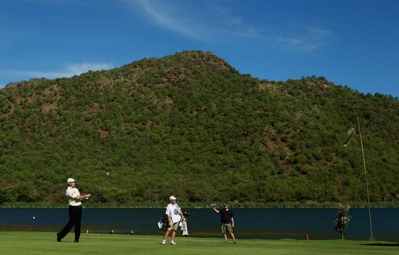 SUN CITY, SOUTH AFRICA - DECEMBER 05:  Lee Westwood of England plays his second shot into the 17th green during the final round of the 2010 Nedbank Golf Challenge at the Gary Player Country Club Course  on December 5, 2010 in Sun City, South Africa.  (Photo by Warren Little/Getty Images)