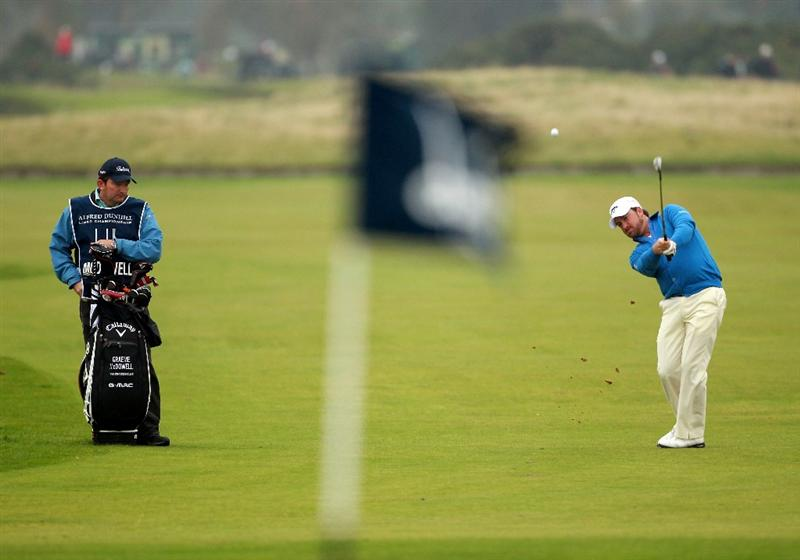 CARNOUSTIE, SCOTLAND - OCTOBER 09:  Graeme McDowell of Northern Ireland plays his second shot to the 18th green during the third round of The Alfred Dunhill Links Championship at the Carnoustie Golf Links on October 9, 2010 in Carnoustie, Scotland.  (Photo by Andrew Redington/Getty Images)