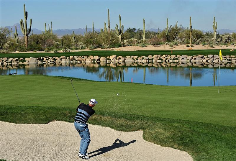 MARANA, AZ - FEBRUARY 26:  Stewart Cink plays a bunker shot on the third hole during the second round of the Accenture Match Play Championship at the Ritz-Carlton Golf Club at Dove Mountain on February 26, 2009 in Marana, Arizona.  (Photo by Stuart Franklin/Getty Images)