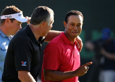 SAN DIEGO - JUNE 15:  Tiger Woods celebrates with caddie Steve Williams after sinking his birdie putt on the 18th green to force a playoff with Rocco Mediate as Lee Westwood of England looks on during the final round of the 108th U.S. Open at the Torrey Pines Golf Course (South Course) on June 15, 2008 in San Diego, California.  (Photo by Harry How/Getty Images)