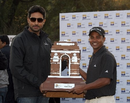 DELHI, INDIA - FEBRUARY 10:  S.S.P.Chowrasia of India with the trophy and 'Bollywood' superstar Abhishek Bachman of India after the final round of the Emaar-MGF Indian Masters at the Delhi Golf Club, on February 10, 2008 in Delhi, India.  (Photo by David Cannon/Getty Images)