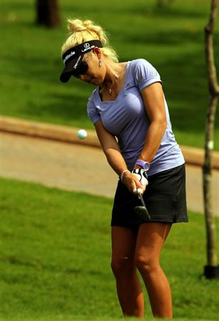 KUALA LUMPUR, MALAYSIA -OCTOBER 21: Natalie Gulbis of USA chips out the rough on the 6th hole during the Sime Darby Pro-Am at the KLGCC Golf Course on October 21, 2010 in Kuala Lumpur, Malaysia.  (Photo by Stanley Chou/Getty Images)