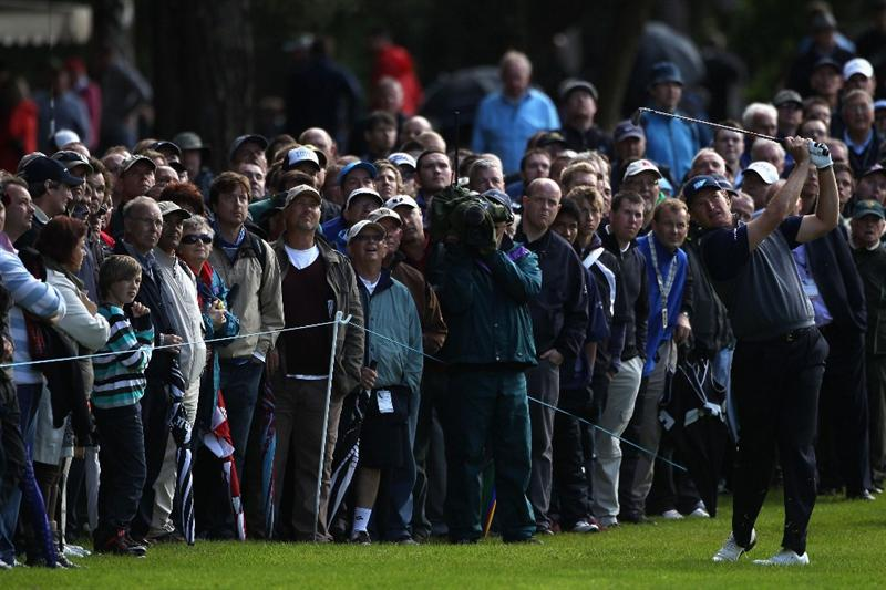 VIRGINIA WATER, ENGLAND - MAY 26:  Ernie Els of South Africa plays an approach shot on the 13th hole during the first round of the BMW PGA Championship at Wentworth Club on May 26, 2011 in Virginia Water, England.  (Photo by Warren Little/Getty Images)