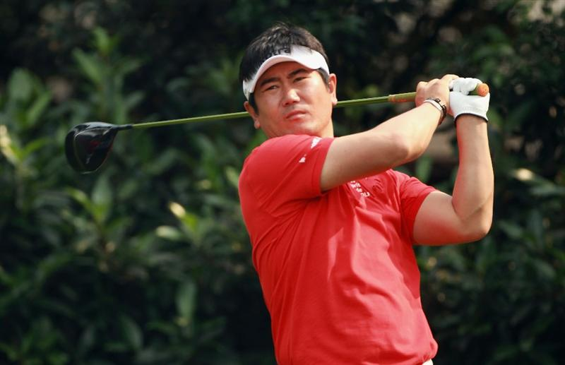 SHANGHAI, CHINA - NOVEMBER 05:  Y.E. Yang of South Korea watches his tee shot on the fifth hole during the second round of the WGC-HSBC Champions at Sheshan International Golf Club on November 5, 2010 in Shanghai, China.  (Photo by Andrew Redington/Getty Images)