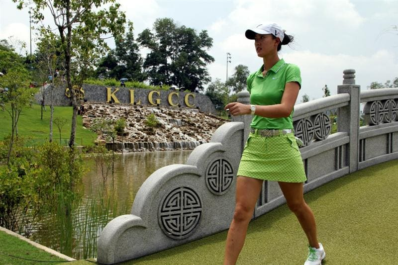 KUALA LUMPUR, MALAYSIA - OCTOBER 24:  Michelle Wie of USA walks across the bridge on the 15th hole during the Final Round of the Sime Darby LPGA on October 24, 2010 at the Kuala Lumpur Golf and Country Club in Kuala Lumpur, Malaysia. (Photo by Stanley Chou/Getty Images)