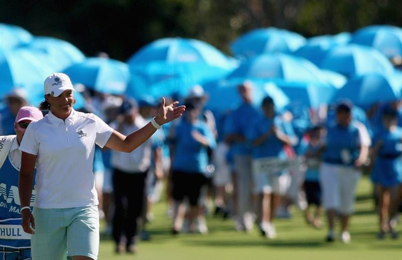 BRISBANE, AUSTRALIA - FEBRUARY 08: Katherine Hull of Australia walks up to the 18th hole as she celebrates victory during day four of the 2009 ANZ Ladies Masters at Royal Pines Resort on February 8, 2009 in Brisbane, Australia.  (Photo by Bradley Kanaris/Getty Images)