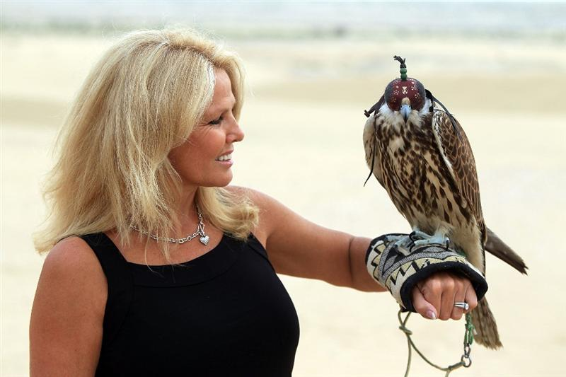 DUBAI, UNITED ARAB EMIRATES - FEBRUARY 05: Hilary Watson the wife Tom Watson of the USA holding a falcon during their visit to the Jumeirah Bab Al Sham desert Resort after his second round of the 2010 Omega Dubai Desert Classic on the Majilis Course at the Emirates Golf Club on February 5, 2010 in Dubai, United Arab Emirates.  (Photo by David Cannon/Getty Images)