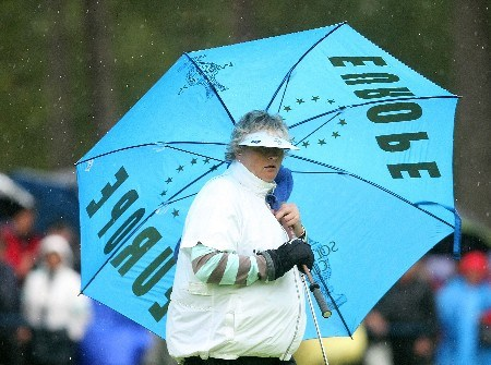 HALMSTAD, SWEDEN - SEPTEMBER 14:  Laura Davies of Europe waits under an umbrella during the afternoon fourball matches of the Solheim Cup at on September 14, 2007 in Halmstad, Sweden.  (Photo by Scott Halleran/Getty Images)