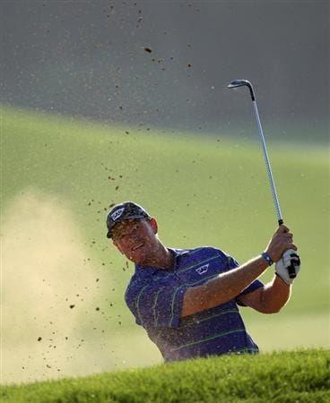 DUBAI, UNITED ARAB EMIRATES - JANUARY 30:  Ernie Els of South Africa plays his third shot on the par four 6th hole during the second of round of the Dubai Desert Classic played on the Majlis Course on January 30, 2009 in Dubai,United Arab Emirates.  (Photo by Ross Kinnaird/Getty Images)