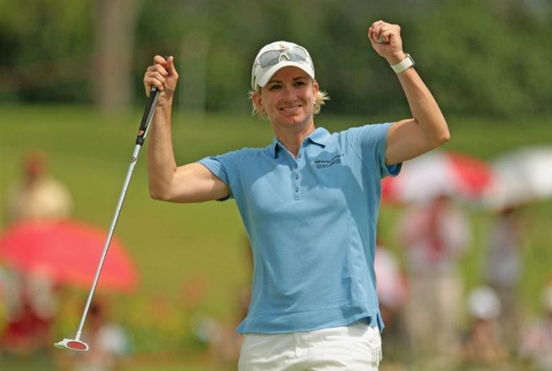 SINGAPORE - FEBRUARY 27:  Karrie Webb of Australia celebrates her one-stroke victory at the HSBC Women's Champions 2011 at the Tanah Merah Country Club on February 27, 2011 in Singapore, Singapore.  (Photo by Scott Halleran/Getty Images)