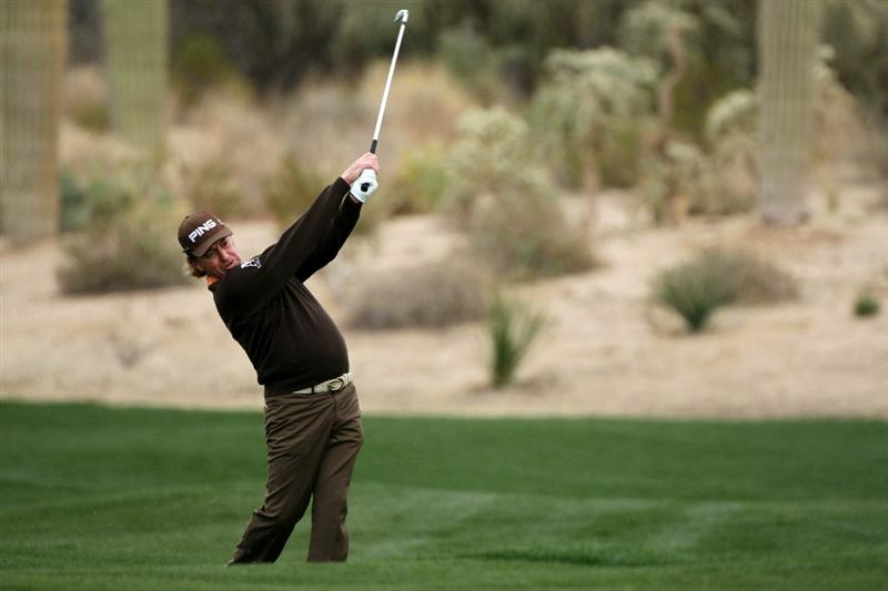 MARANA, AZ - FEBRUARY 26:  Miguel Angel Jimenez of Spain hits an approach shot on the second hole during the quarterfinal round of the Accenture Match Play Championship at the Ritz-Carlton Golf Club on February 26, 2011 in Marana, Arizona.  (Photo by Andy Lyons/Getty Images)