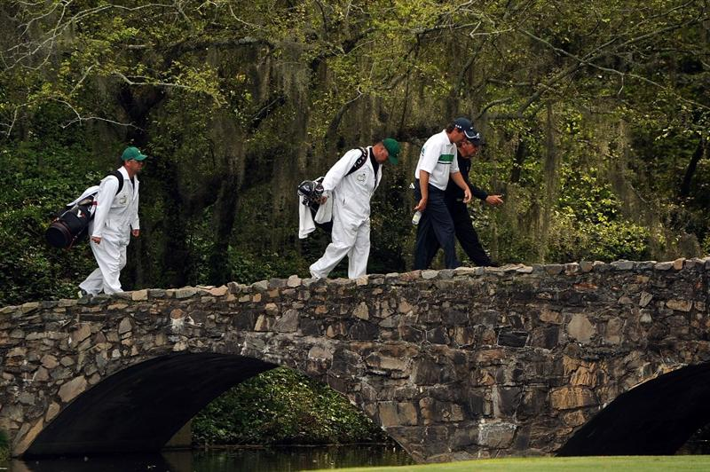 AUGUSTA, GA - APRIL 10:  Stephen Ames of Canada and Gary Player of South Africa cross the Nelson Bridge with their caddies during the second round of the 2009 Masters Tournament at Augusta National Golf Club on April 10, 2009 in Augusta, Georgia.  (Photo by Harry How/Getty Images)